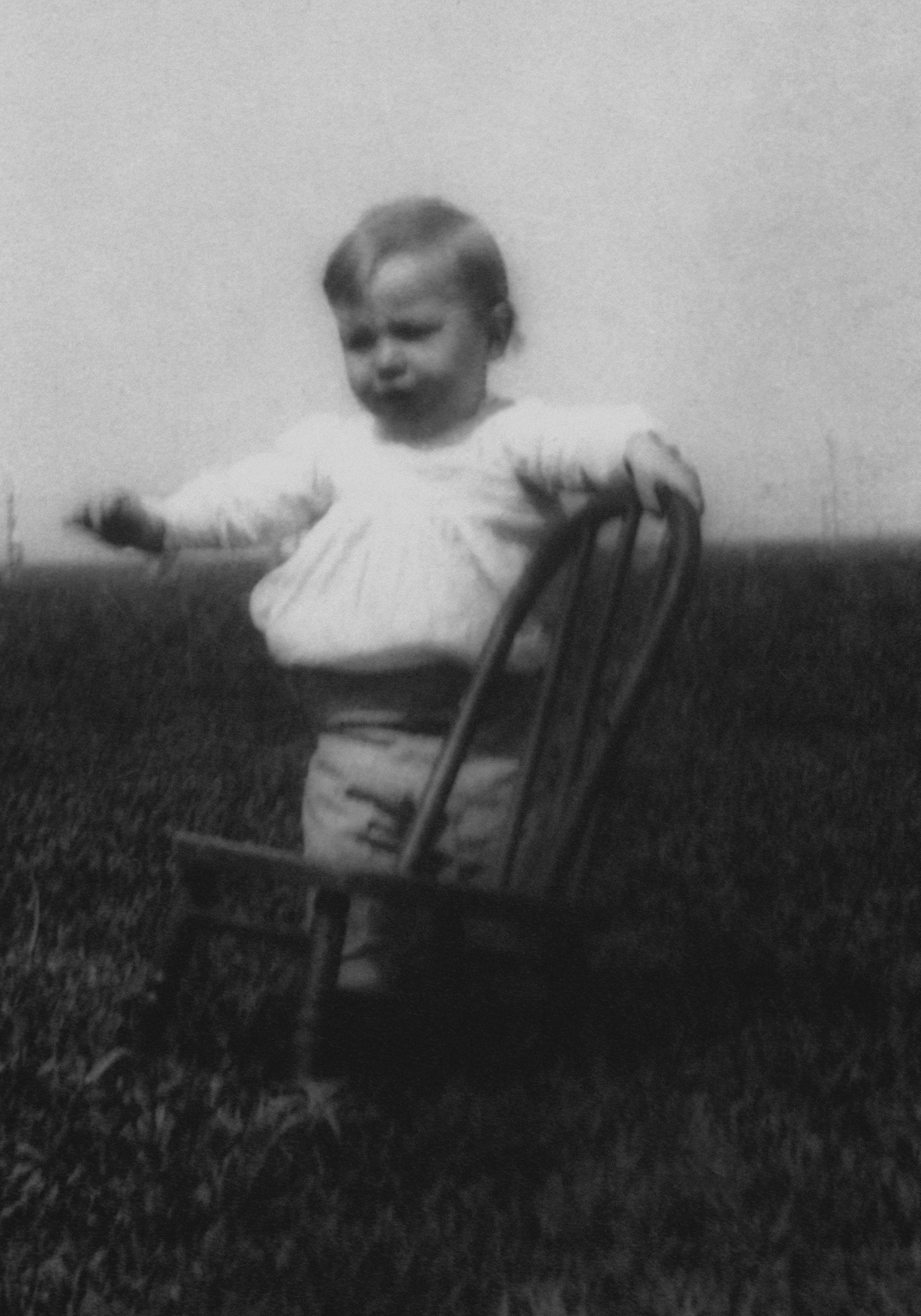 Kid with chair in field copy